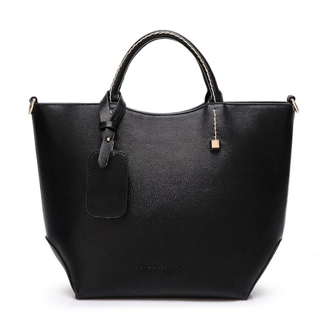 leather bucket handbag | thelaxboutique.com