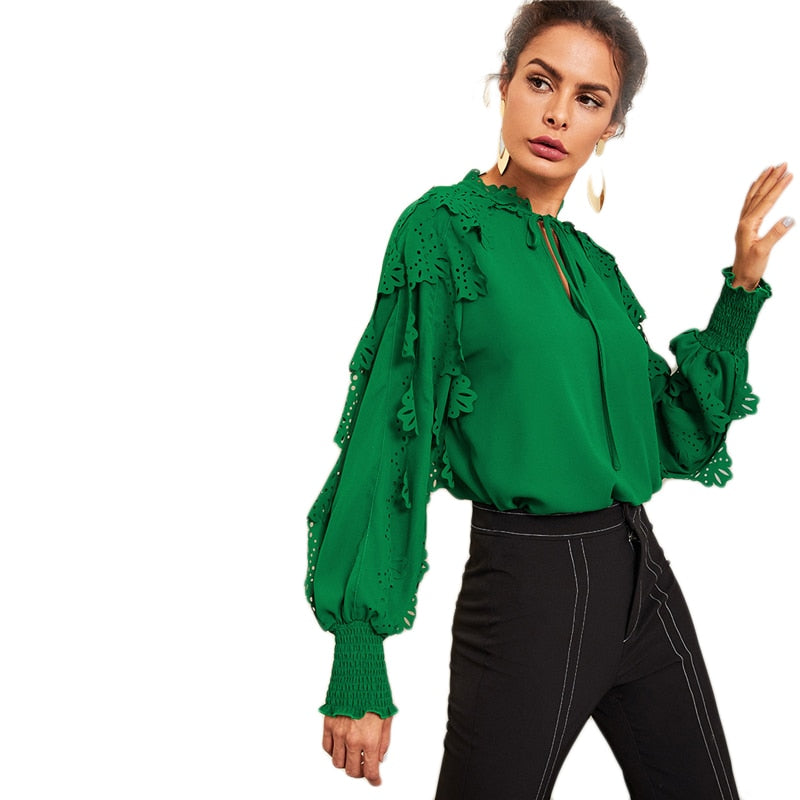 the green top, ruffled sleeves