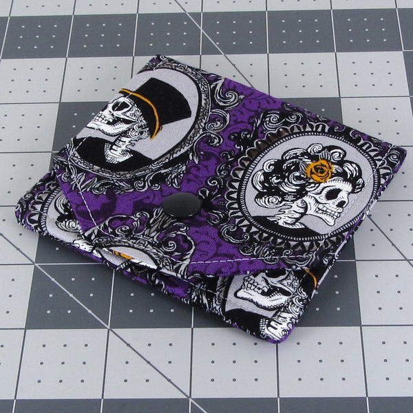 purple skull earbud case