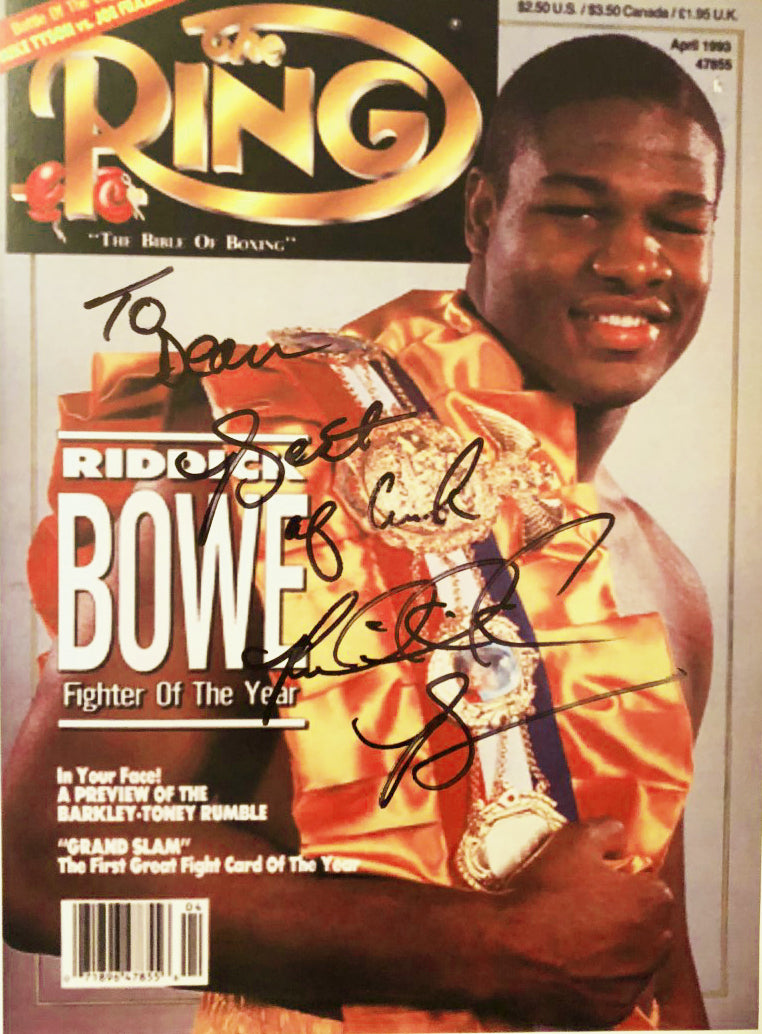 Riddick Bowe Autographed with inscriptions 8 x 10 Photo