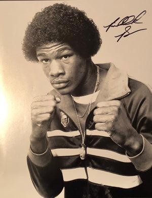 Riddick Bowe 11 x 14 autographed photo of a young Heavyweight Champion Bowe