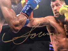 Vasyl Lomachenko action packed Autographed 8x10 fighting photo with a Gold Signature, JSA