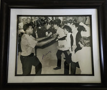 Muhammad Ali Autographed 16 x 20 size Photo in Black and white with the Beatles, SSG certified.