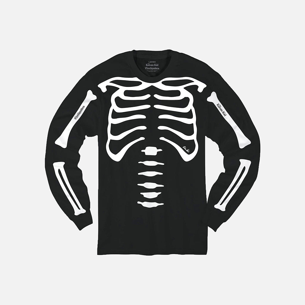 front of cobra kai long sleeve shirt with white skeleton bones on black