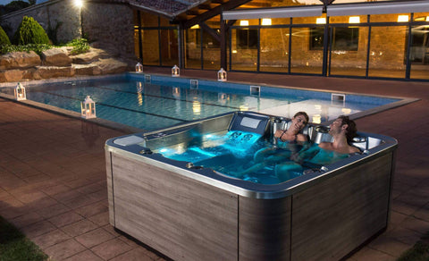 Sauna Welcome Image - A couple relaxing in an outdoor hot tub