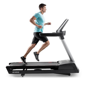 Man Jogging on the FreeMotion t10.9 Interval REFLEX™ Treadmill.