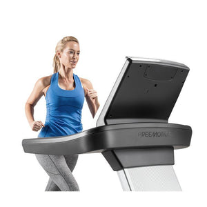 Woman Running on the FreeMotion t10.9 Interval REFLEX™ Treadmill.