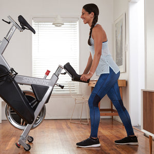 Spinner A1 Lifestyle Image - Easily move your Spin Bike with its wheels.