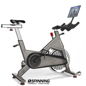 Spinner P1 Performance Series Spin Bike shown with optional tablet and tablet mount.