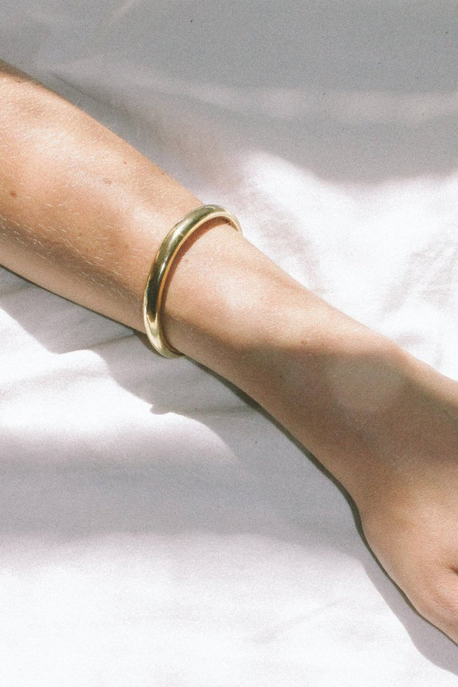 Load image into Gallery viewer, Wolf Circus Assembly Cuff Bracelet Gold