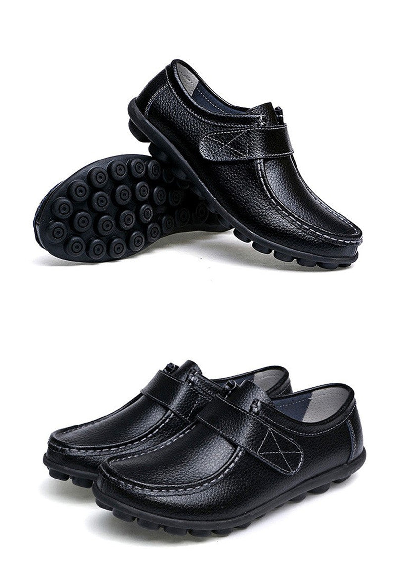 black leather nodule shoes with the black nodule soles and a smart leather strap fixing
