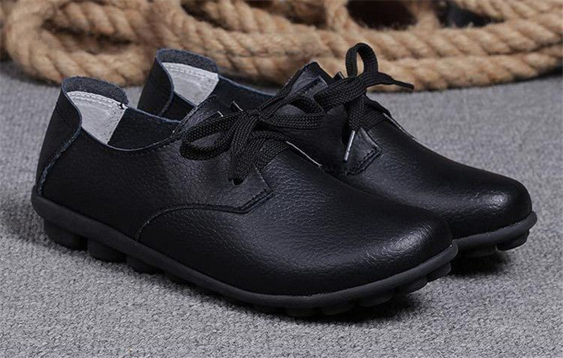 classic black leather lace up comfortable womens shoes with black nodule soles near the nice rope