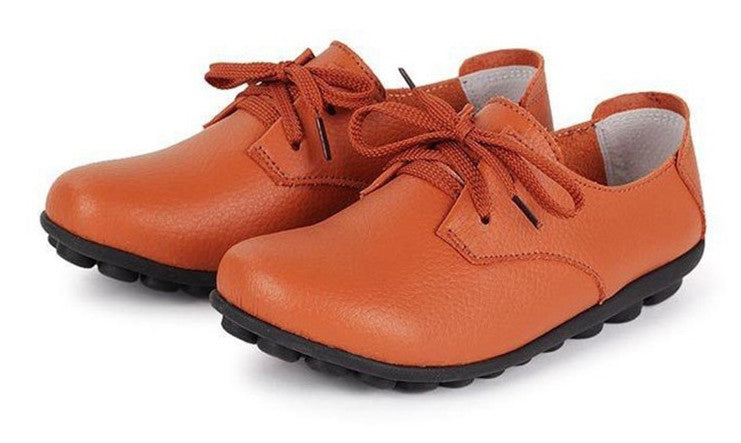 classic orange leather lace up comfortable womens shoes with black nodule soles see the nodules yes