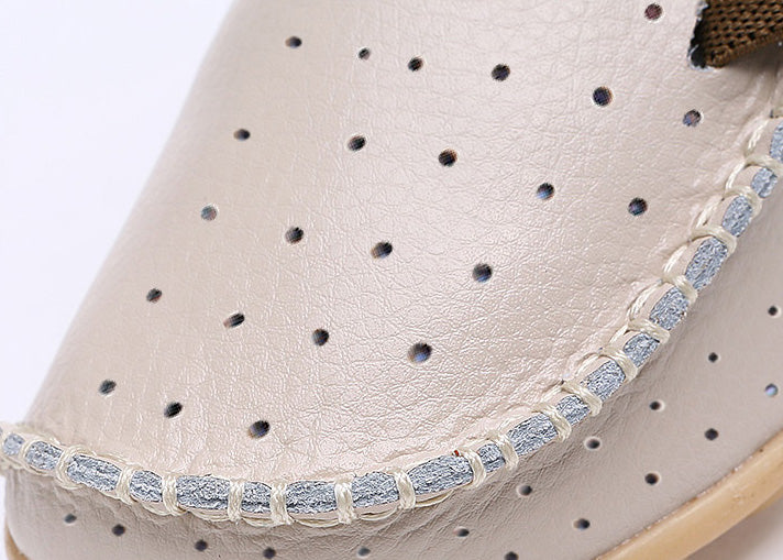 close up showing the stitching at the toe for the breathable nodule with side lace feature