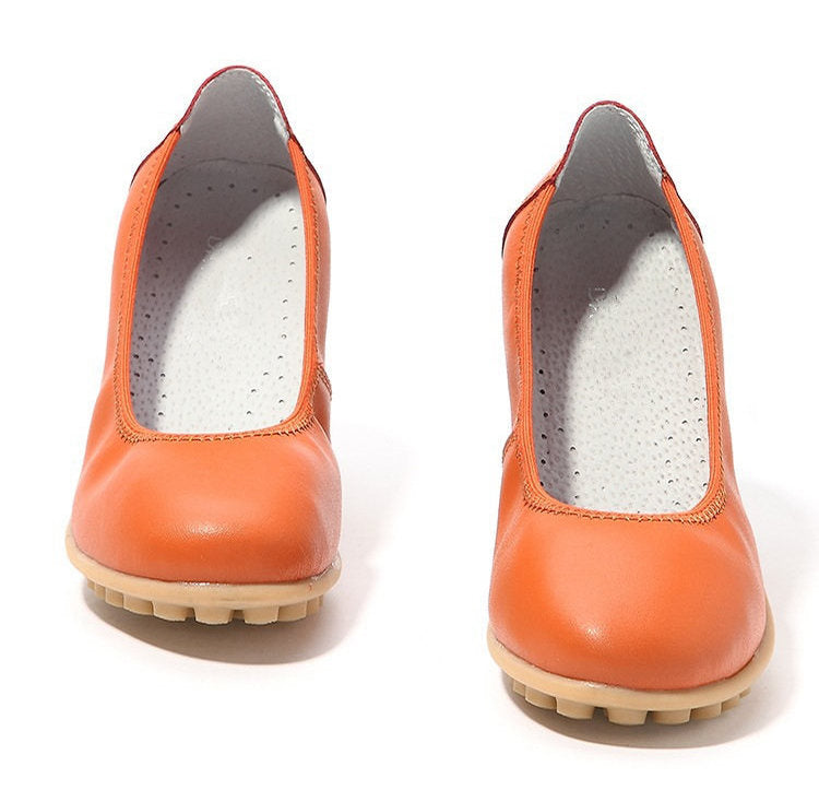 orange leather covered toe nodule shoes