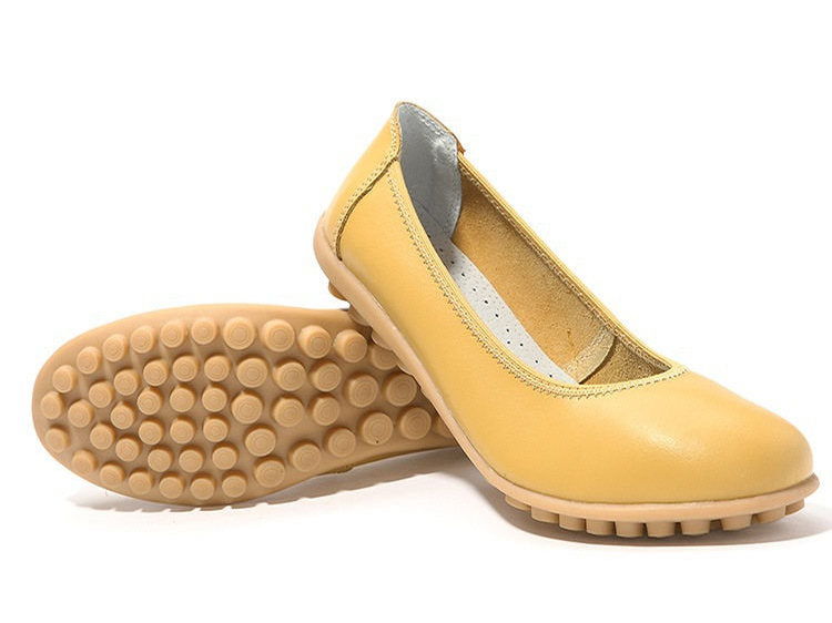 covered toe nodule shoe with the yellow finish