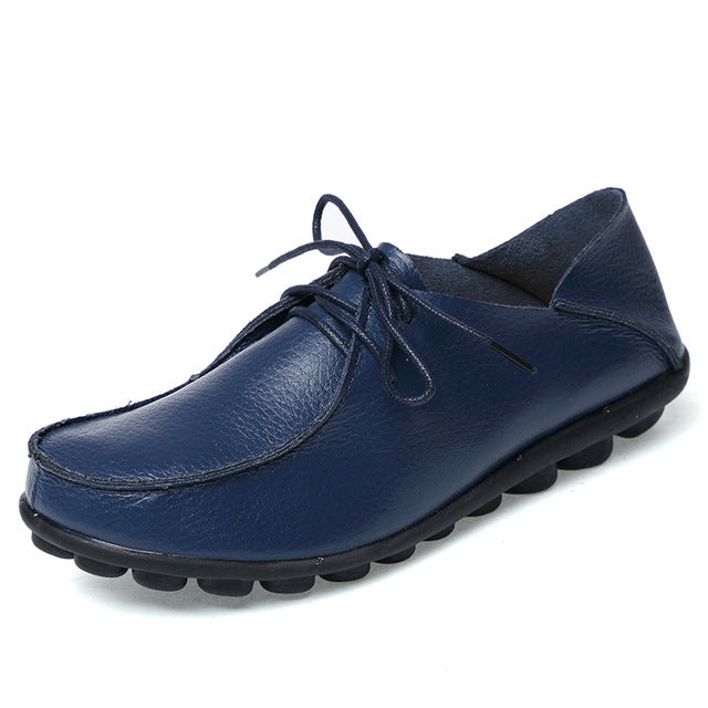 featuring dark blue lace up leather womens shoes with black nodulated grippy base