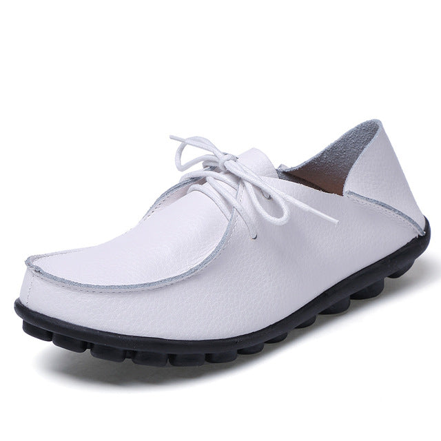 featuring pure white lace up leather womens shoes with black nodulated grippy base