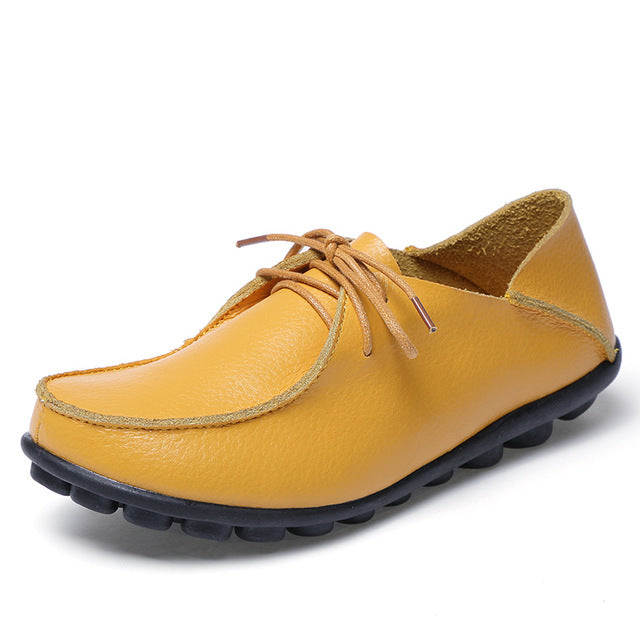 featuring sunburst yellow lace up leather womens shoes with black nodulated grippy base