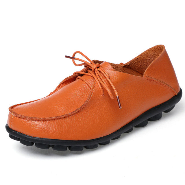 featuring warm orange lace up leather womens shoes with black nodulated grippy base