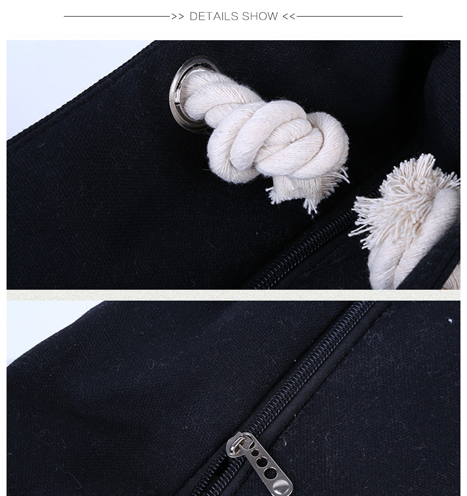 rope knots on the end of the handles of the tote bag