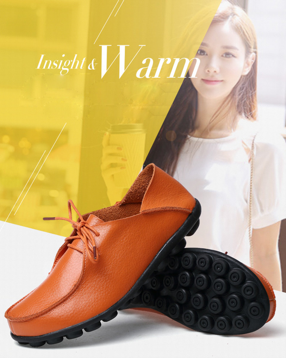 slip on moccasin style comfortable lace up leather womens shoes with black nodulated sole showing orange pair shoes