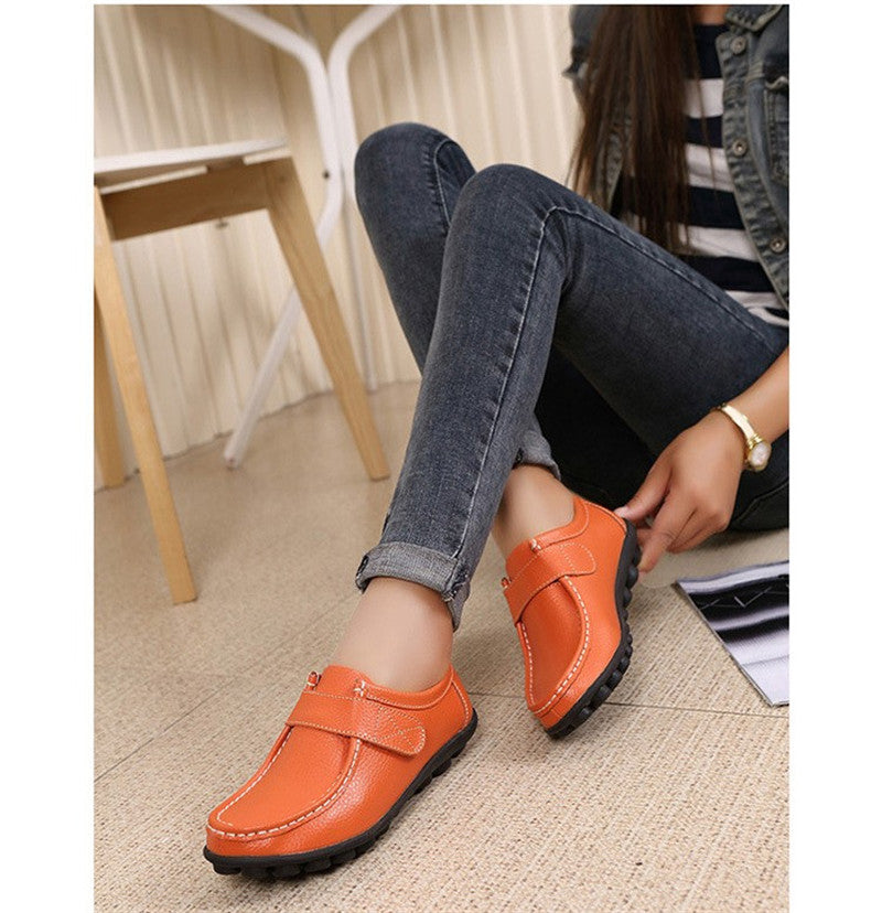 so cool orange leather womens shoes with black rubber sole nodules
