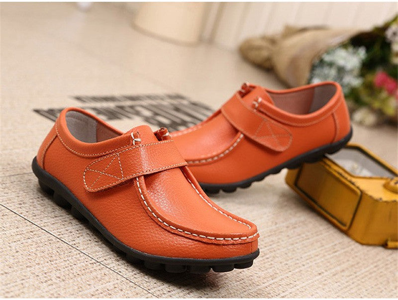 swish orange leather womens shoes with black rubber sole nodules