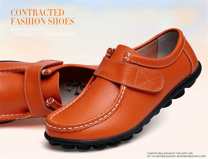 swish orange leather womens shoes with black rubber sole nodules nice closeup looks great