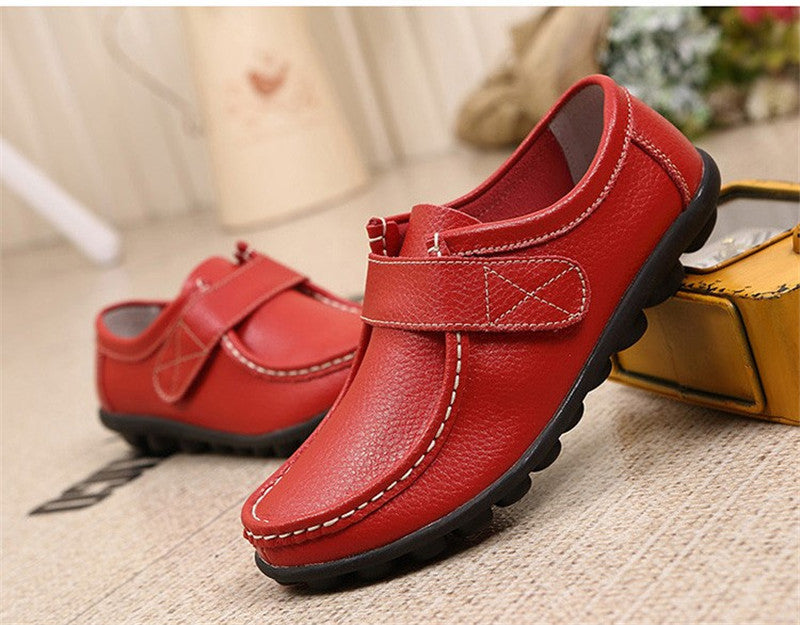 swish red leather womens shoes with black rubber sole nodules nice closeup looks great