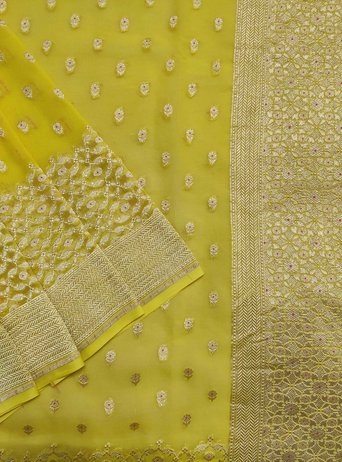 Lime yellow khaddi georgette handloom Banarasi saree with mini flower booti (2) Close up