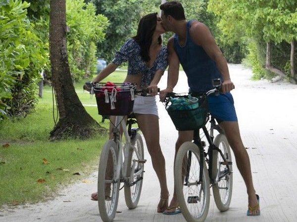 Bachelorette Becca Kufrin biking in FRAME white shorts