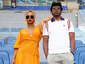 Beyonce wears yellow GANNI dress in Rome tour