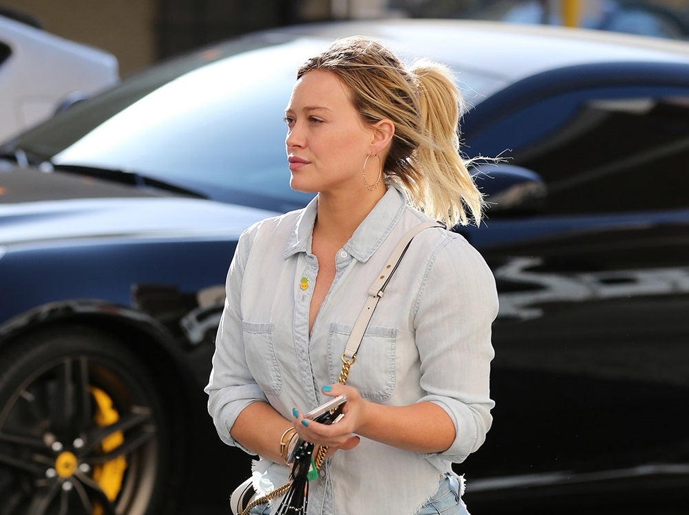 Hilary Duff wearing Golden Goose sneakers