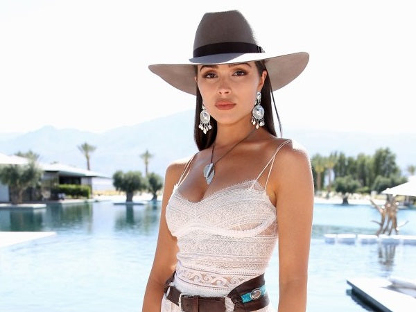 Olivia Culpo dresses the part in a Gladys Tamez Millinery Hat