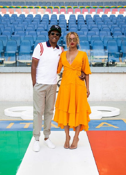 Beyonce wearing a yellow Ganni dress in Rome