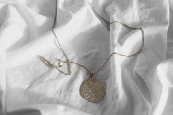 shop ethical sustainable & ethical clothing by EMBR jewellery Silver midnight sun necklace long