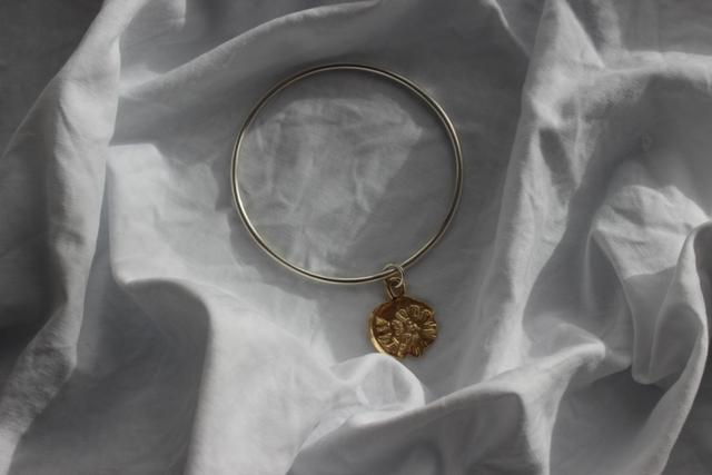 PRE ORDER  -  Delivery early December - Gold midnight sun bangle