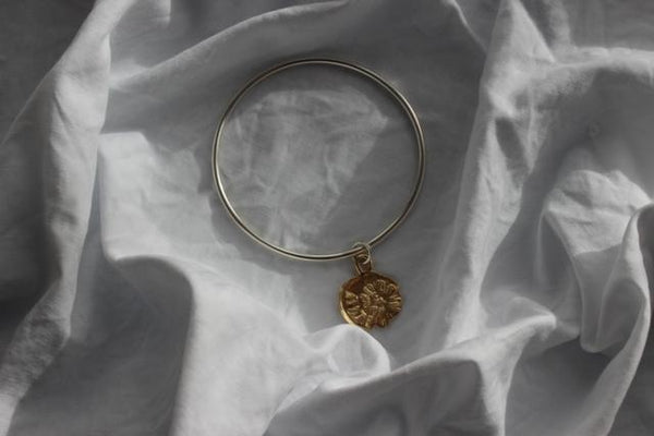 shop ethical sustainable & ethical clothing by EMBR jewellery Gold midnight sun bangle