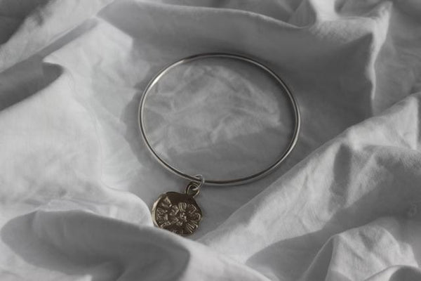 Silver midnight sun bangle