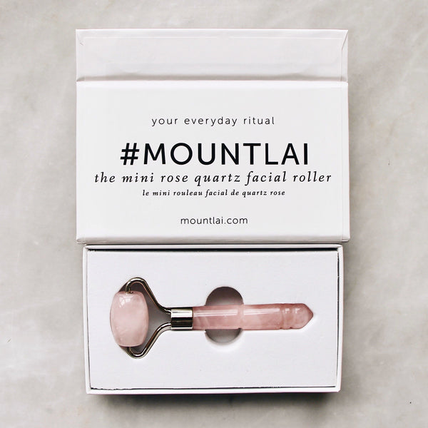 The De-Puffing Mini Rose Quartz Roller