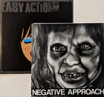 "Negative Approach - S/T 7"" + Easy Action - She Ain't My Girlfriend 7"""