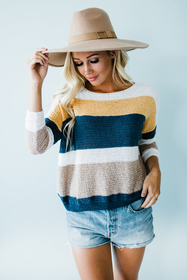 Blue and mustard knit sweater