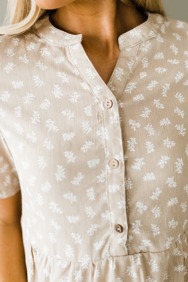 Tan button down top with floral design
