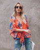Image of Womens Summer Floral Bell Sleeve Loose V-Neck T Shirt Knot Tie Front Casual Tops Blouse | Edlpe