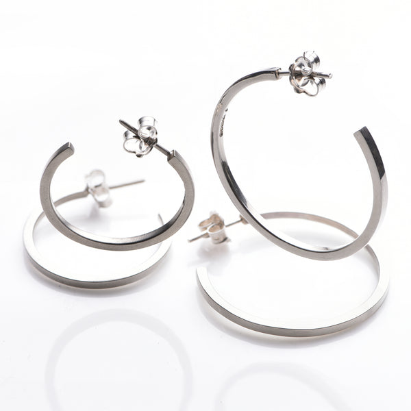 Hoop earrings in 925 sterling silver.  Hall marked. 7.5 cm external circumference, soft matt grey finish.  9.5 cm external circumference high shine finish.  www.ellielane.com