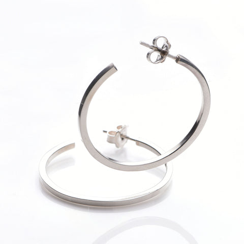 Hoop earrings in 925 sterling silver. Hall marked. 9.5 cm external circumference. High shine finish. www.ellielane.com