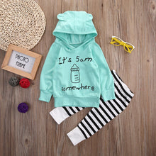 Fun printed hoodie long sleeve t-shirt with striped pants.