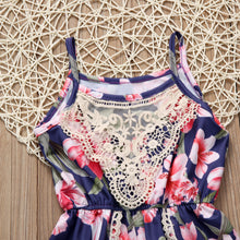 Gorgeous backless floral print romper with lace detail.
