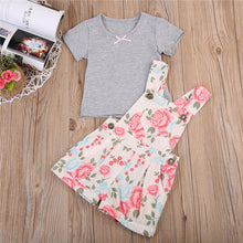 Gorgeous floral overalls shorts with a stylish grey t-shirt.